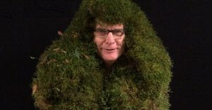 Man wearing moss all over